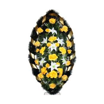 Венок желтый из гвоздик, лилий, хризантем