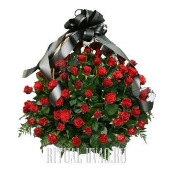 Шикарная траурная корзина из алых Роз
