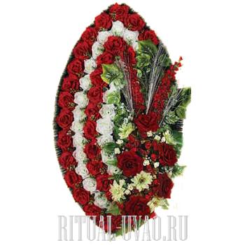 Приличный элегантный похоронный венок