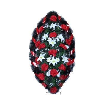 Венок красный из гвоздик, лилий, хризантем