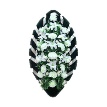 Венок белый из гвоздик, лилий, хризантем